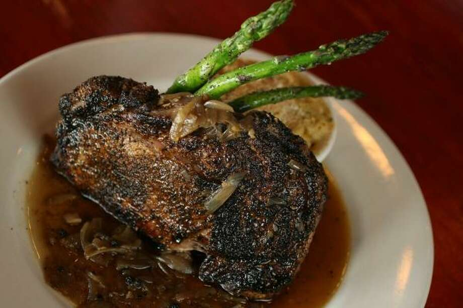La Vista chef/owner Greg Gordon uses a cast-iron skillet to make Cast-Iron Rib-Eye With Brandy-Black Peppercorn Sauce. Photo: MAYRA BELTRÁN, CHRONICLE