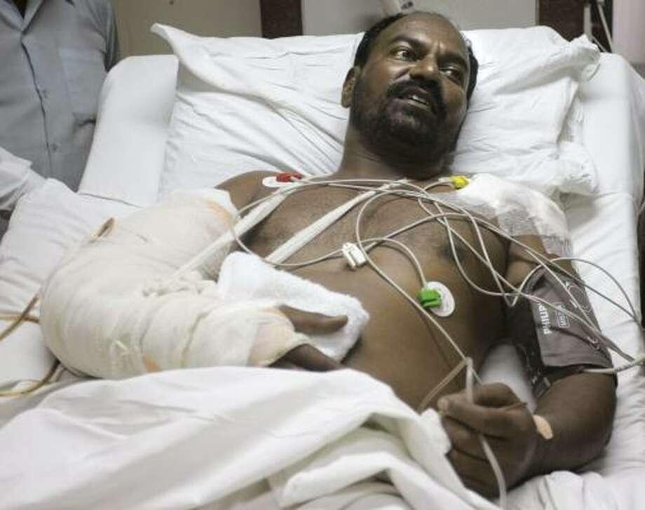 Mumbai police Constable Arun Jadhav recovers from injuries received during last week's terror rampage in Mumbai, India. Photo: RAJANISH KAKADE, ASSOCIATED PRESS