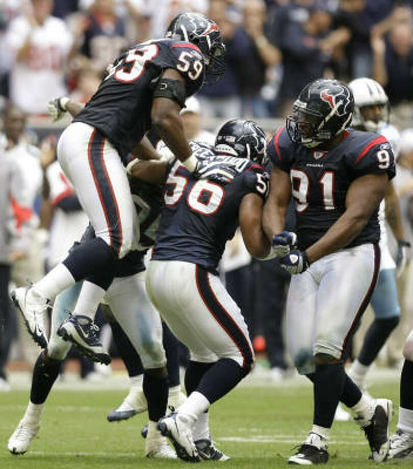 DeMeco Ryans, from left, Morlon Greenwood, Amobi Okoye and the Texans defense has forced 11 turnovers in the past four weeks. Photo: Brett Coomer, Chronicle