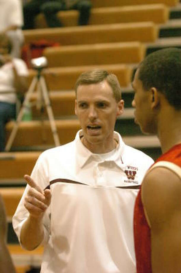 Cy Woods boys head coach Chris Draudt, son of Cy Falls boys head coach Jim, has coached his team to a 21-2 record. Photo: Eddy Matchette, For The Chronicle