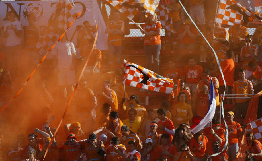 You can always count on an electric atmosphere at Dynamo games thanks to supporters' groups such as Texian Army, above. Photo: Julio Cortez, Houston Chronicle