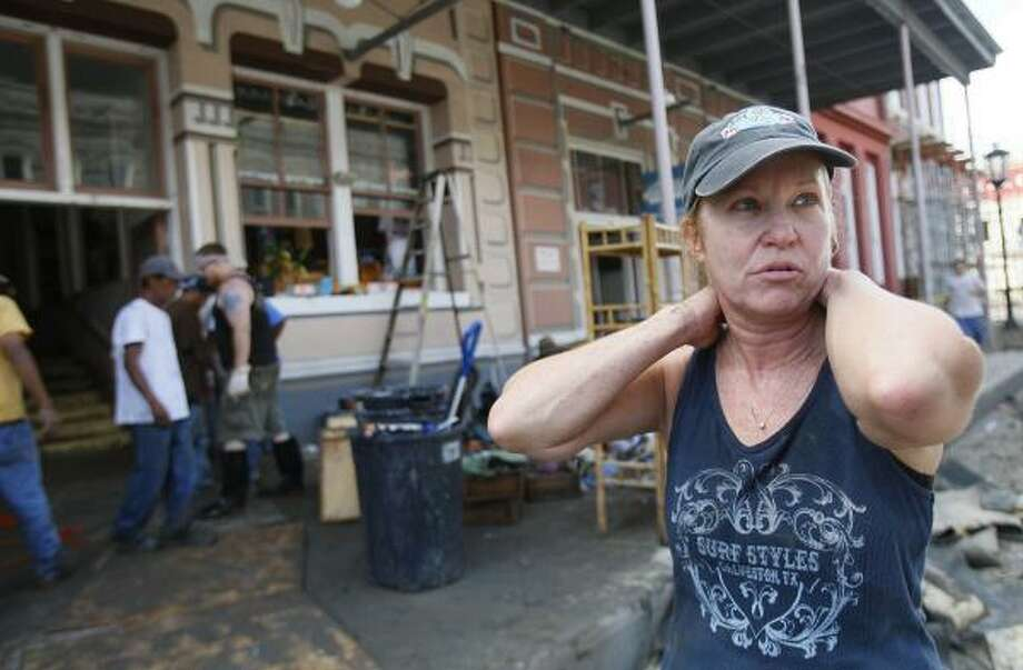 """Joani Depingre and her husband, Garry, cried when they saw their store Monday, but said """"we're going to rebuild."""" Photo: MAYRA BELTRÁN, CHRONICLE"""