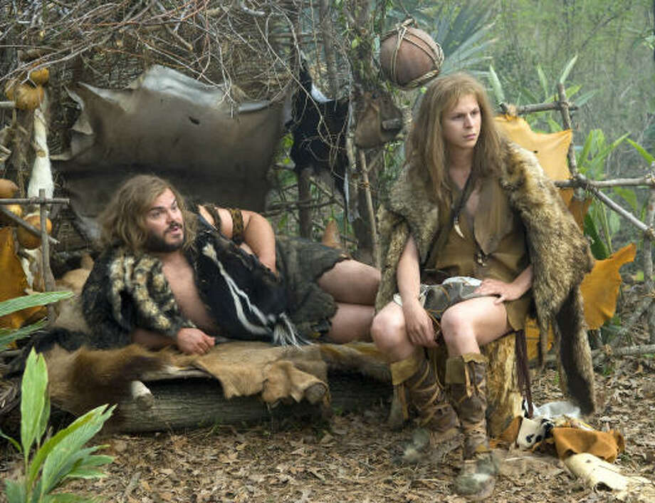 In Year One, Jack Black, left, and Michael Cera play two inept cave men who are banished from their village and explore their prehistoric world. Photo: SUZANNE HANOVER :, COLUMBIA PICTURES