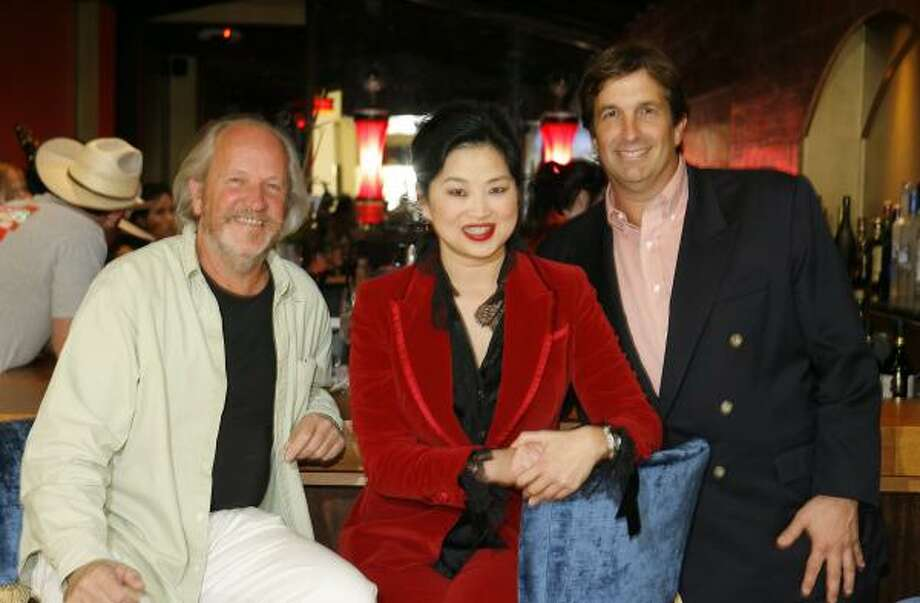 Marcel Maison with Gigi Huang and John Goodman at the opening of Gigi's Asian Bistro and Dumpling Bar in the Galleria. Photo: STEVE CAMPBELL, CHRONICLE
