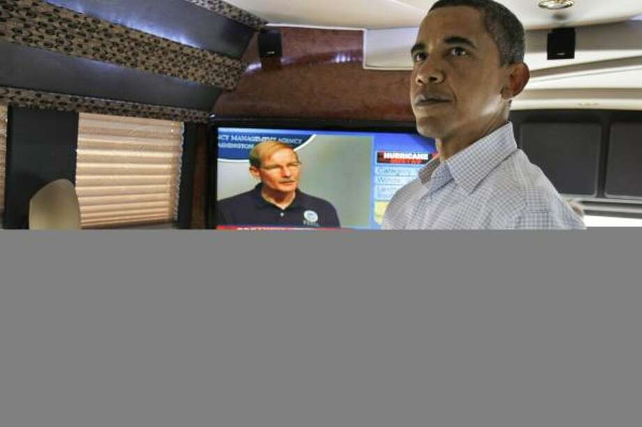 Barack Obama stays close to the TV on his campaign bus to watch news of Gustav in Toledo, Ohio, on Monday. Photo: ALEX BRANDON, ASSOCIATED PRESS