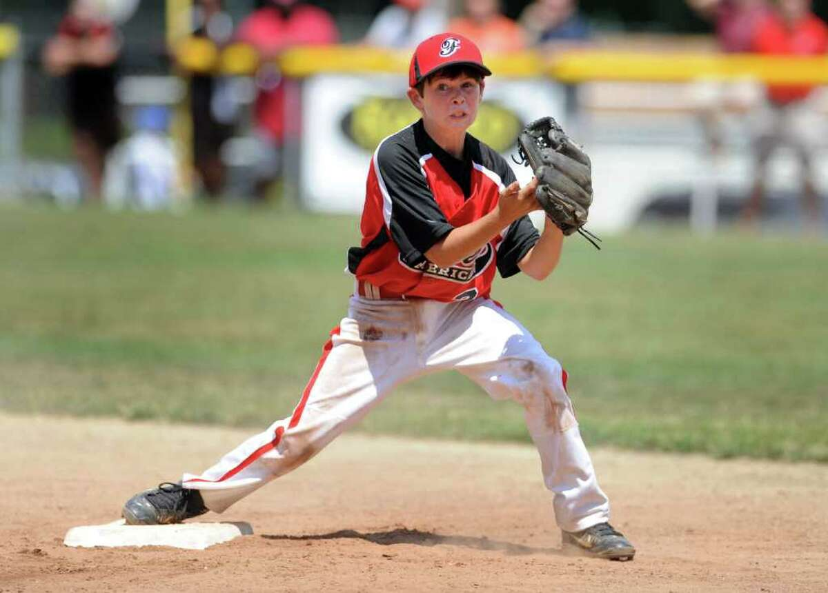 Connor Lynch fields a ball as Fairfield American plays against Glastonbury American in the Connecticut State Championship game 2 at Prospect Little League Field on Sunday, July 31, 2011.