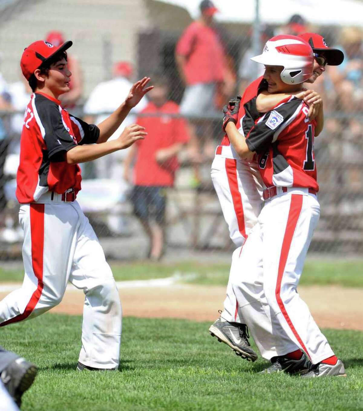 Fairfield American celebrates their win against Glastonbury American in the Connecticut State Championship game 2 at Prospect Little League Field on Sunday, July 31, 2011.