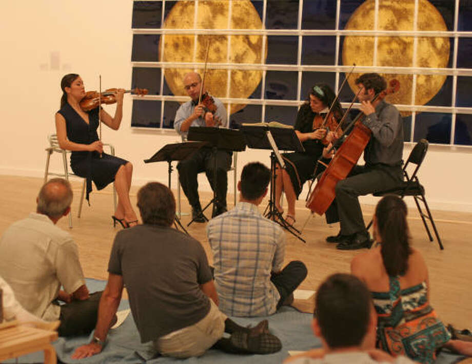 The Enso String Quartet, with Maureen Nelson, violin, from left, John Marcus, violin, Melissa Readon, viola, and Richard Belcher, cello, performs during a Musiqa program at the Contemporary Arts Museum. Photo: Gary Fountain, For The Chronicle