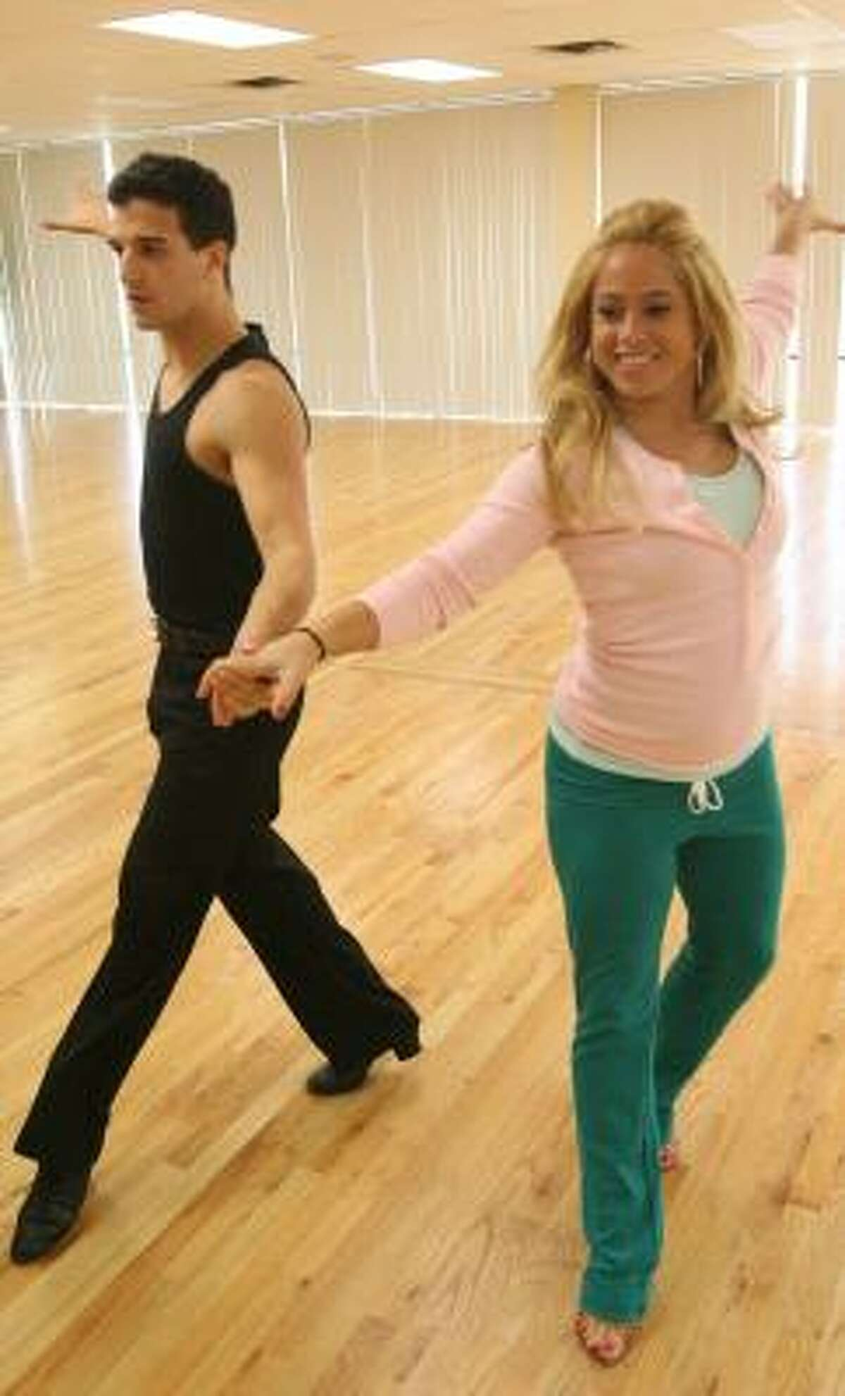 Sabrina Bryan of Cheetah Girls fame and dance pro Mark Ballas demonstrate their cha-cha skills at King's Dancing Centre in Bellaire earlier this week. They were careful not to give away any of their routine before they compete on Dancing With the Stars, which begins Sept. 24.