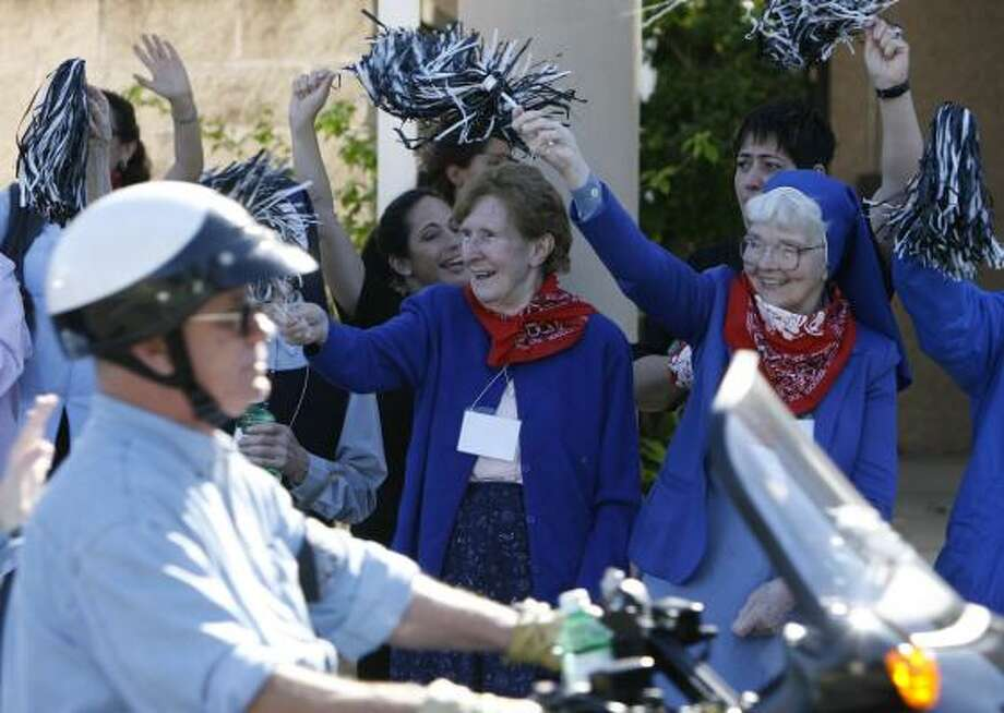 Sister Caroline Flynn, left, and Sister Raphella Curran cheer riders as they leave on the third annual Nun Run on Saturday. The 50-mile motorcycle ride leaves from the Sisters of Charity of the Incarnate Word and ends in Galveston. For more photos, go to chron.com/metro. Photo: MELISSA PHILLIP, CHRONICLE