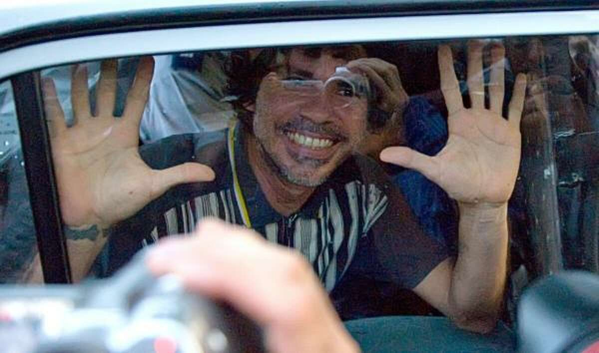 Gorki Aguila, singer of the Cuban punk band Porno Para Ricardo, leaves a Havana court in a police patrol car Friday. He was convicted of public disorder.
