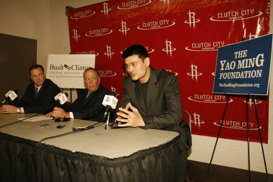Yao Ming, right, and his foundation will be one of the beneficiaries of the Rockets Tux & Tennies Charity Gala. Team CEO Tad Brown, left, and owner Leslie Alexander look on. Photo: Houston Rockets, Courtesy Photo