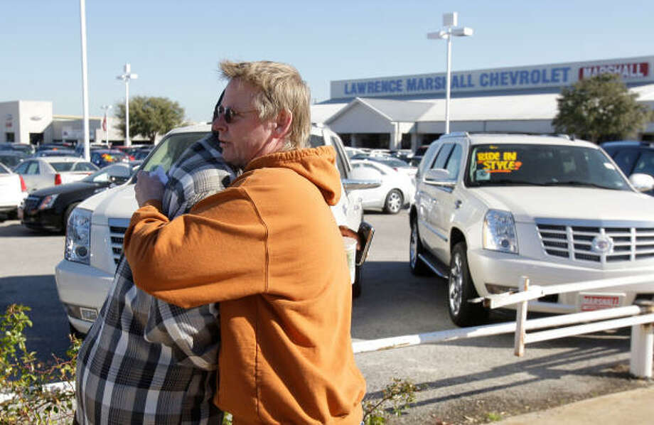 Salesman Robert Wolf, left, and Ford sales manager Michael Frees had a combined 45 years at Lawrence Marshall when the giant dealership closed Wednesday in Hempstead. Photo: Melissa Phillip, Chronicle