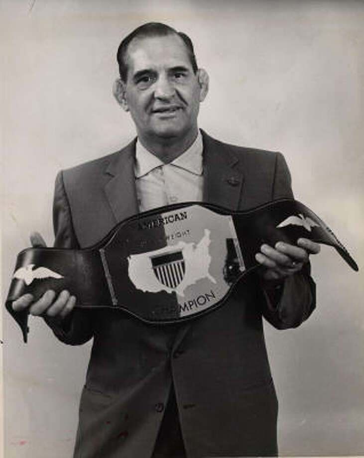 "Paul Boesch, here with his 1962 title belt, became a respected match promoter and popular ringside television commentator. ""He was a cut above,"" remembered Eldridge Coleman, who wrestled in Houston in the 1970s and '80s. ""First, he was a genius in promotion and, secondly, he was a gentleman. That's extremely rare in the sordid business of pro-wrestling."" Photo: Chronicle File"