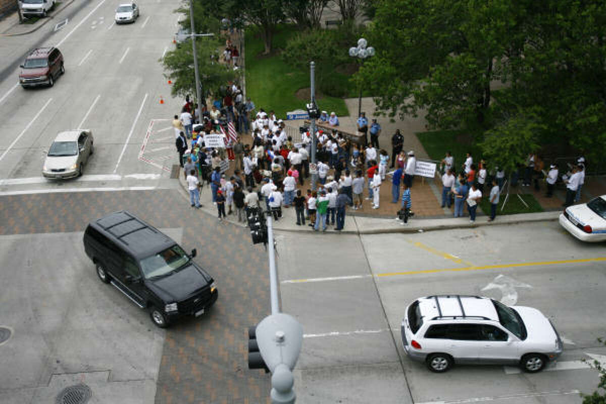 The crowd gathers Friday at the federal office building in Houston in support of immigration reform.
