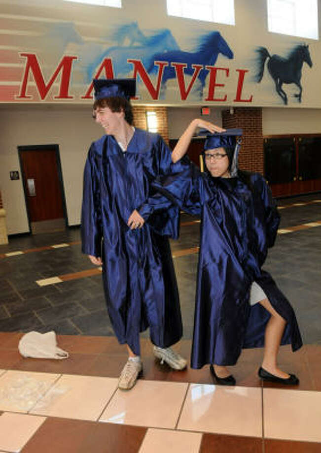 PIONEERS: Manvel High School's salutatorian Johnathan Dietz and valedictorian Tiffany Han goof around as they show off their cap and gown for the school's first-ever graduation ceremony, which will be June 6. Photo: Kim Christensen, For The Chronicle