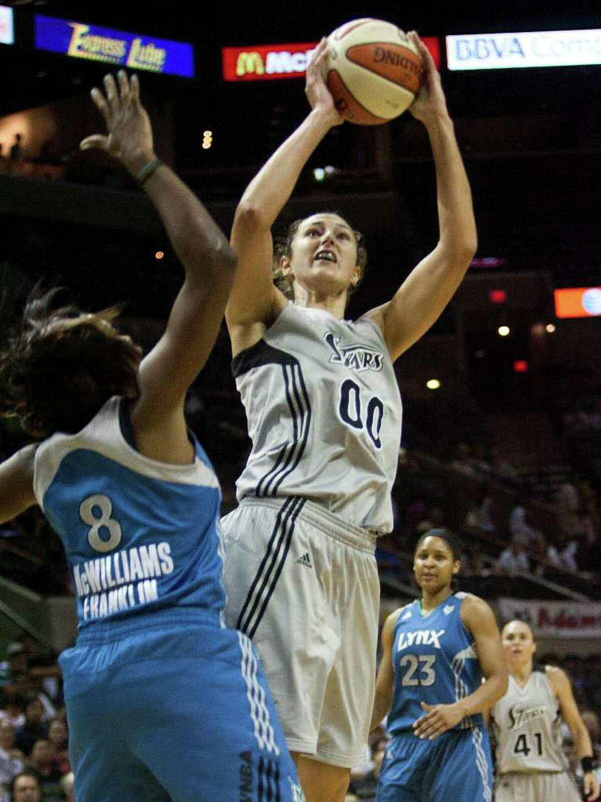 Silver Stars center Ruth Riley shoots against Minnesota Lynx center Taj McWilliams-Franklin on Sunday, July 31, 2011, at the AT&T Center. Riley had eight points in the Stars' 70-69 loss to the Lynx.