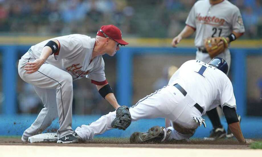 Milwaukee Brewers' Corey Hart, front right, is tagged out by Houston Astros' Clint Barmes while trying to steal second base during the first inning of a baseball game on Sunday, July 31, 2011, in Milwaukee. Photo: Jeffrey Phelps/Associated Press