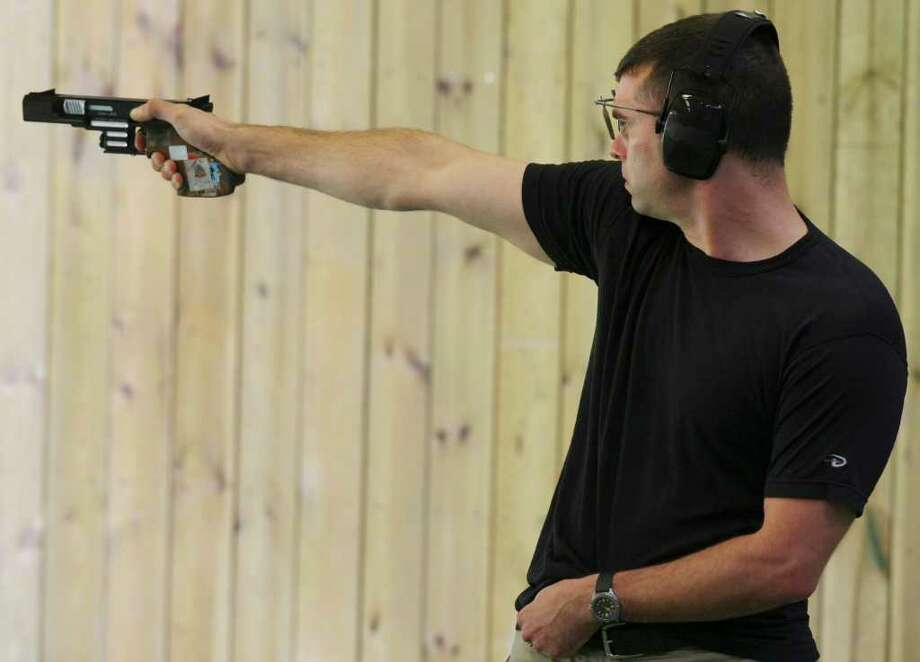 Keith Sanderson competes in a qualification round of the men's 25-meter rapid-fire pistol at the 2008 Beijing Olympics. Sanderson has a good chance to make the U.S. squad again after finishing fifth in Beijing. Photo: Edward A. Ornelas, San Antonio Express-News / eornelas@express-news.net