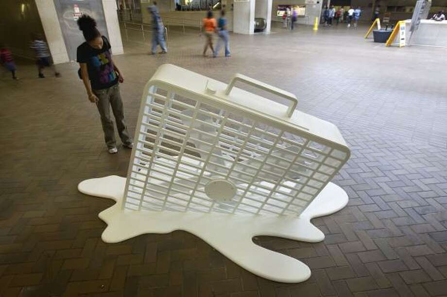 In this photo, an art installation of a melting fan sits on display in a subway station in Atlanta. A cold front that had a decent chance of lowering Houston's temperatures by Friday is now projected to come earlier next week, meteorologists predict. Photo: David Goldman, Associated Press