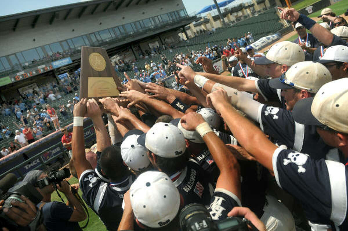 The Brazoswood Buccaneers hoist their Class 5A state baseball championship trophy after defeating Lubbock Coronado 10-3.