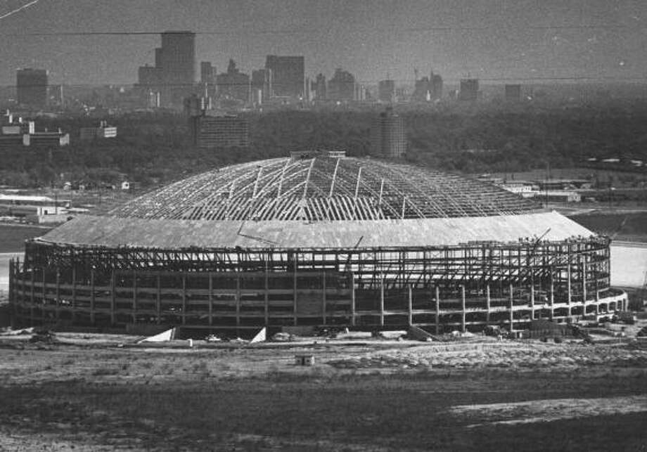 Shown under construction in 1964, the Houston Astrodome was built for Major League Baseball. The future of the Eighth Wonder of the World is in doubt, as the county tries to determine what to do with the stadium. Most events have moved next door to the new Reliant Stadium. Photo: Ted Rozumalski, Houston Chronicle