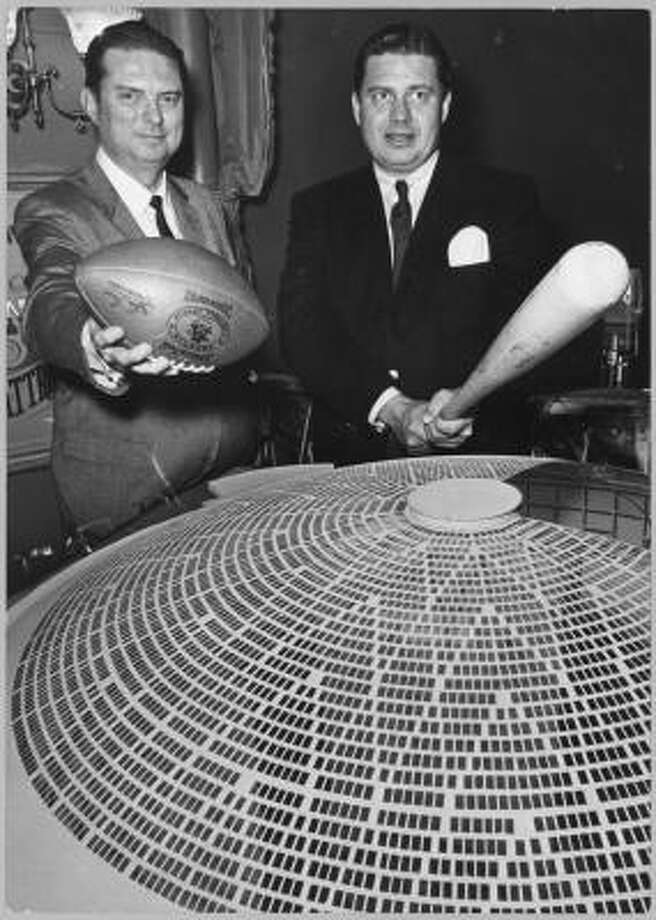 In 1961, Bud Adams, right, owner of the Oilers, poses with Roy Hofheinz, president of the Colt .45s, as they make a pitch to voters for building the proposed domed stadium. At the time, Adams said the stadium would assure the continuance of professional football and baseball in Houston. Photo: Richard Pipes, Houston Chronicle