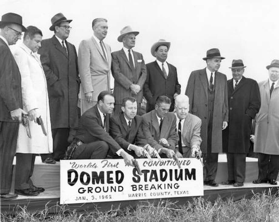 At the January 1962 groundbreaking ceremony for the Harris County Domed Stadium, civic leaders eschewed shovels in favor of Colt 45s. Photo: HOUSTON CHRONICLE