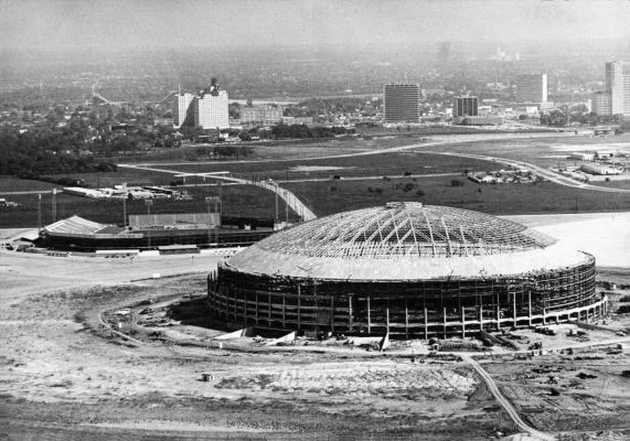 The Harris County Domed Stadium is shown in 1964, several months before it was opened.  The old Colt stadium, which was home to Houston's heat, mosquitoes and Colt .45s baseball team, stands at upper left. Photo: Sam C. Pierson, Houston Chronicle