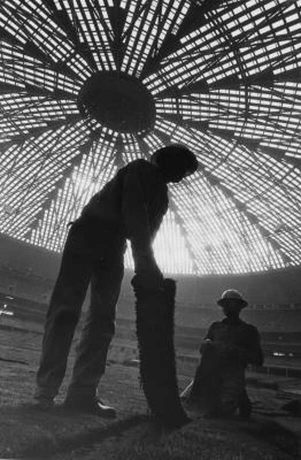 Astrodome construction - Workers pull up the grass to make way for AstroTurf. Photo: RICHARD PIPES, Houston Chronicle