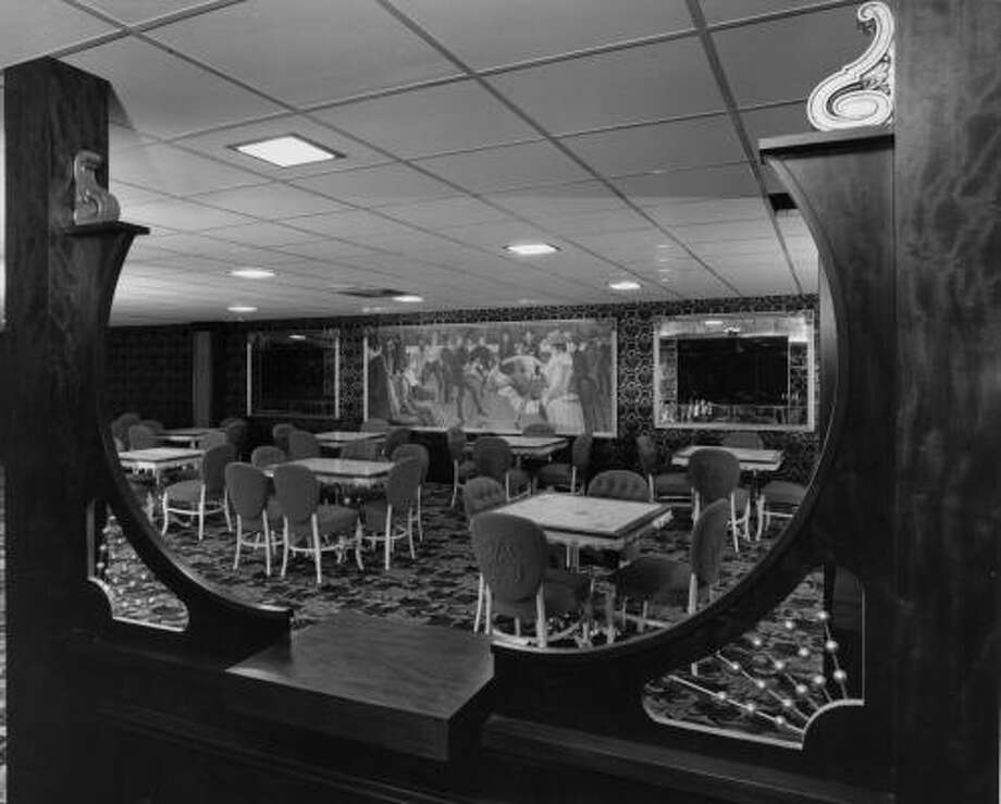 A sneak peak into the 1965 view of the Astrodome Club, one of the plushest rooms under the Dome, complete with swinging doors and dancing girl painting. Photo: HOUSTON CHRONICLE