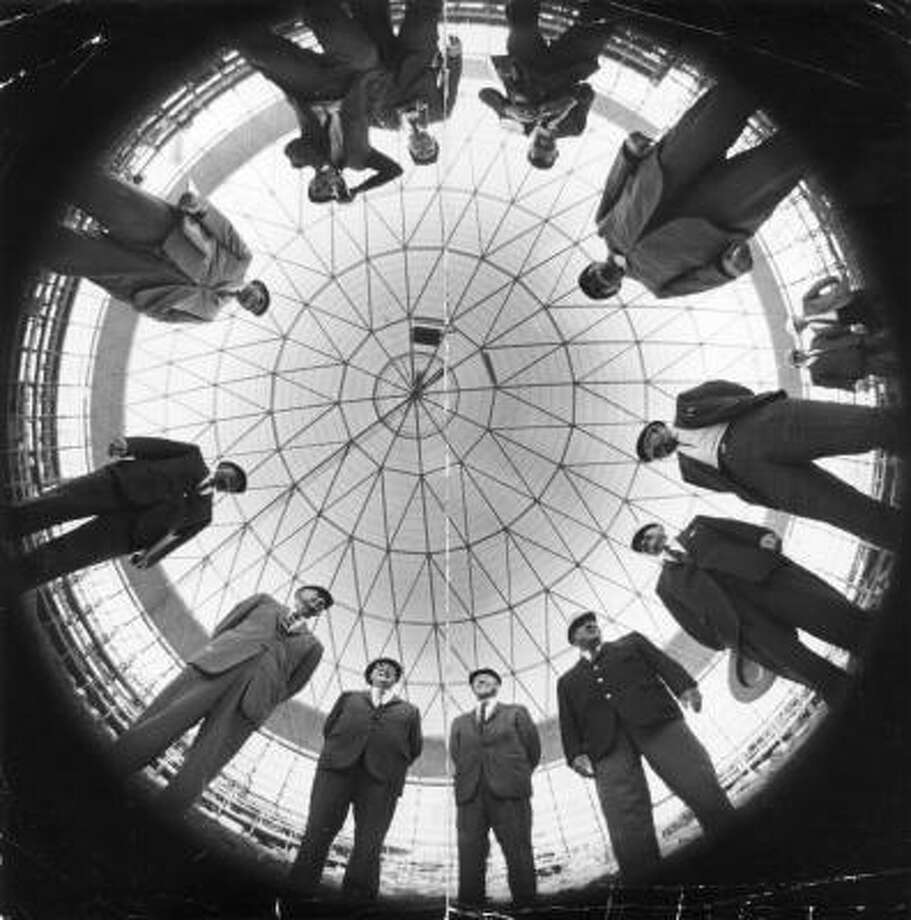 Harris County, Houston Sports Association and National League officials stand under the dome of the partially completed Astrodome, April 3, 1965. Photo: Ted Rozumalski, Houston Chronicle