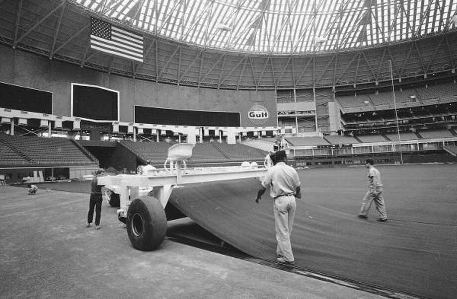 This is a 1966 file photo showing artificial turf being installed at the Astrodome in Houston. Photo: AP