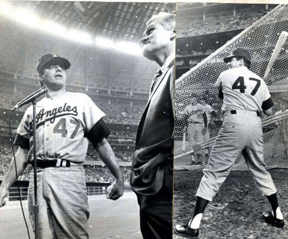 Comedian Jerry Lewis invaded the Domed Stadium in 1966. At left, in Dodger uniform, he accepts key to city from Houston councilman Johnny Goyen.  At right, he takes cut at batting practice ball. Photo: Darrell Davidson, Houston Chronicle
