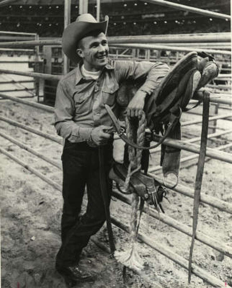 Larry Mahan, an Oregonian by birth and a Texan by choice, competed for his fifth consecutive All-Around Cowboy title at the Astrodome during the 39th annual Houston Livestock Show and Rodeo in 1968. Photo: Jim Coker, Houston Chronicle