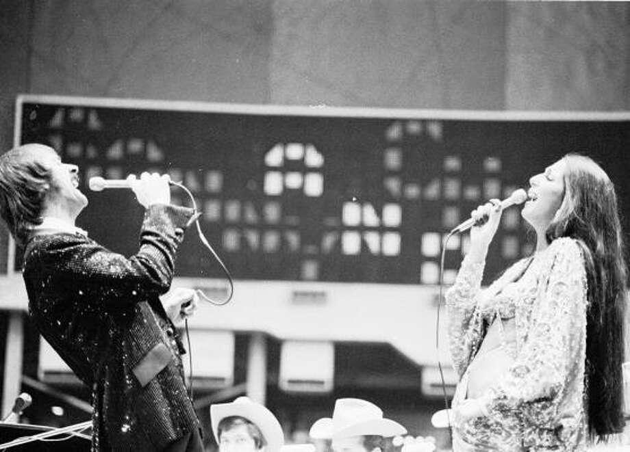 Sonny & Cher perform at the Houston Livestock Show & Rodeo in the Astrodome in 1974. Photo: Bill Clough, Houston Chronicle