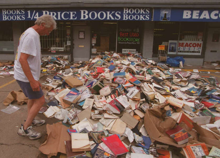 Larry Turk of 1/4th Priced Books looks over thousands of volumes that were damaged by flood water from Tropical Storm Allison. Turk claimed the water peaked at around 4 feet in his Shepherd St. business. Photo: KIM CHRISTENSEN, SPECIAL TO THE CHRONICLE