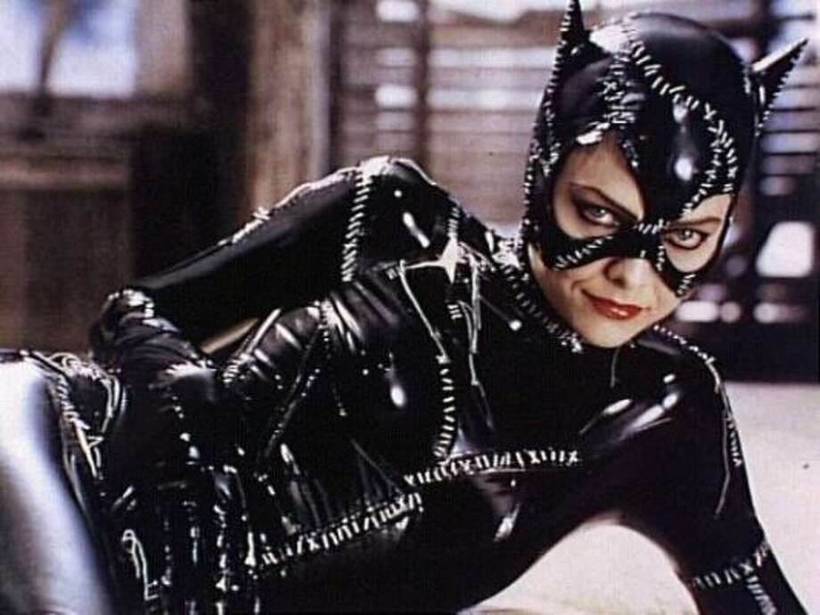 "PHOTOS: Christmas movies for people that hate Christmas movies  Here's Michelle Pfeiffer as Catwoman in 1992's ""Batman Returns"", a film which was released in the summer but was decidedly full of creepy Christmas cheer and black leather.  >>>Learn about other Christmas movies you might have slept on... Photo: AP"