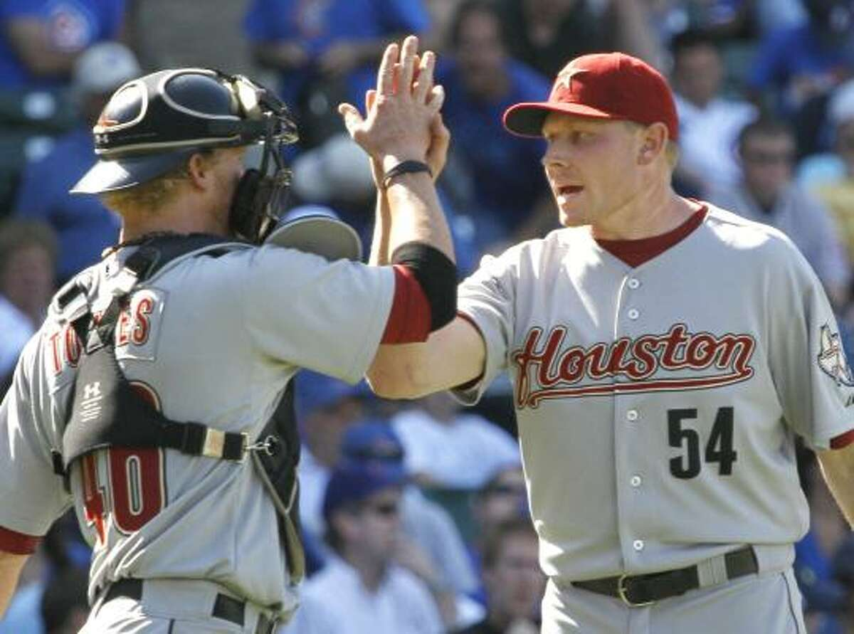 Astros catcher J.R. Towles, left, celebrates the sweep with closer Mark Melancon.