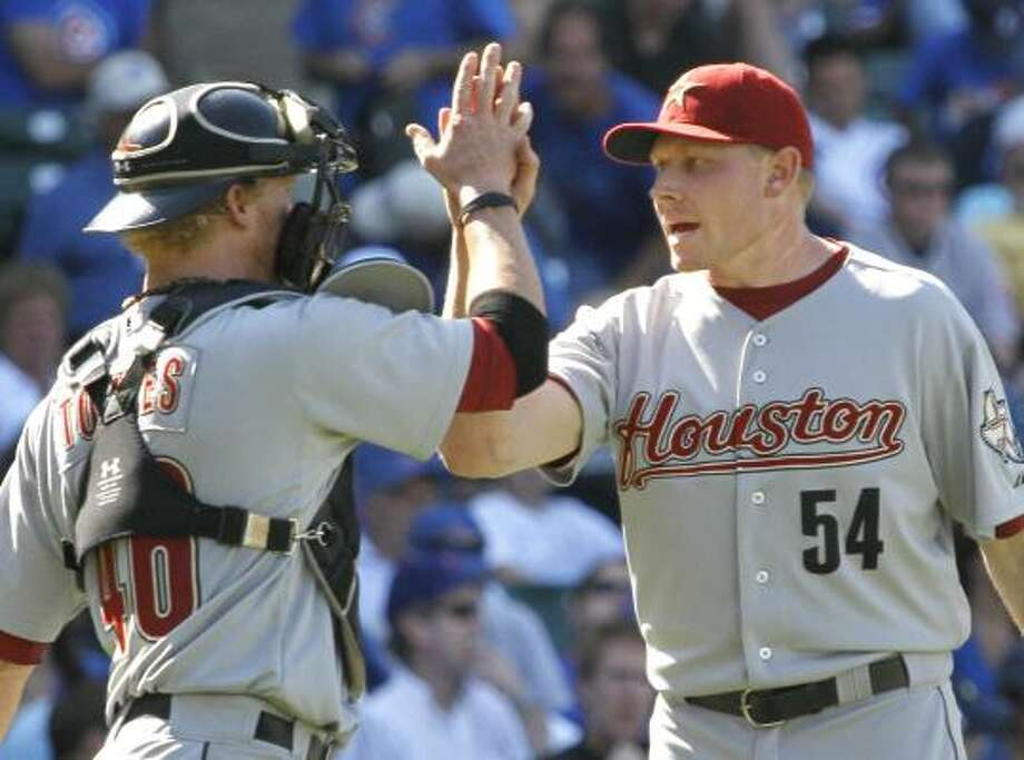 Astros catcher J.R. Towles, left, celebrates the sweep with closer Mark Melancon. Photo: Charles Rex Arbogast, Associated Press