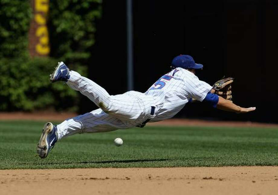 Darwin Barney of the Cubs dives to try and reach a ball hit by Clint Barnes. Photo: Jonathan Daniel, Getty