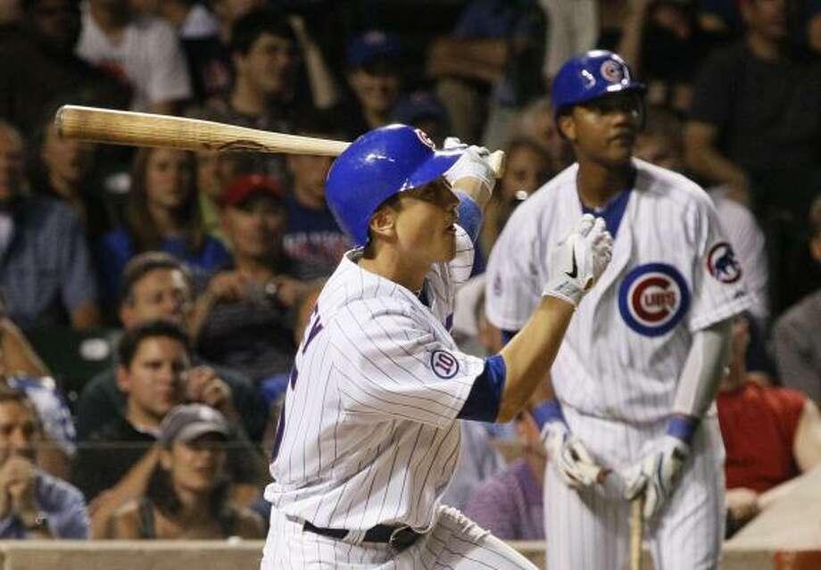 Cubs' Darwin Barney follows through on a hit. Photo: Charles Rex Arbogast, Associated Press