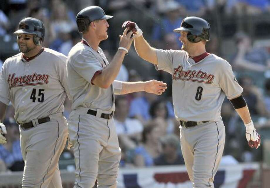 May 30: Astros 12, Cubs 7   Jeff Keppinger (right) is met at the plate by Carlos Lee,(left) and Hunter Pence after Keppinger's homer. Photo: Tom Cruze, Associated Press