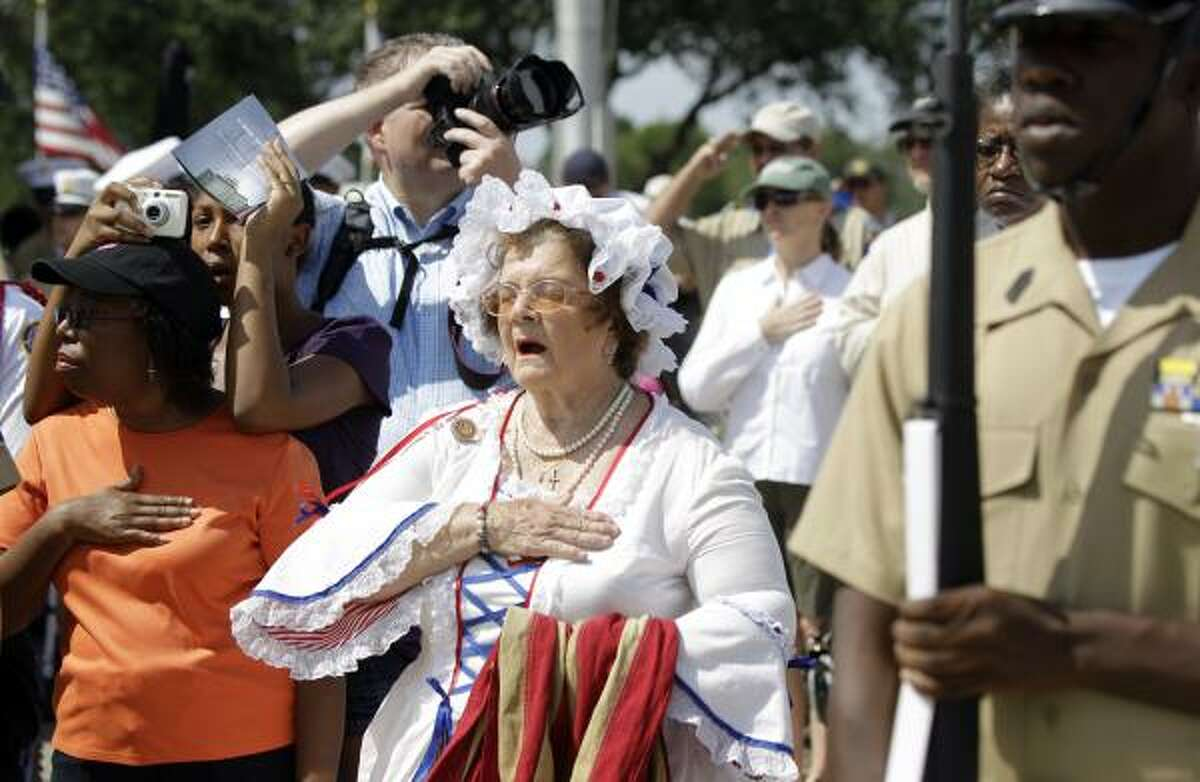 Ginny Evans with the Tejas Chapter of the Daughters of American Revolution dresses as Betsy Ross during the Memorial Day ceremony Monday at Houston National Cemetery.