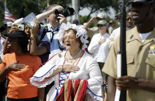 Ginny Evans with the Tejas Chapter of the Daughters of American Revolution dresses as Betsy Ross during the Memorial Day ceremony  Monday at  Houston National Cemetery. Photo: Melissa Phillip, Houston Chronicle