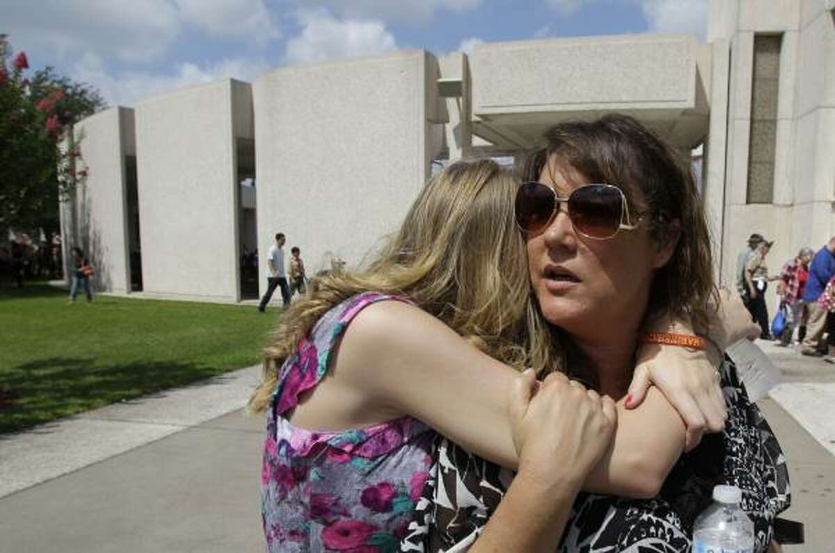 Diane Wallace, 14, hugs her mother, Debora Wallace, on Monday.