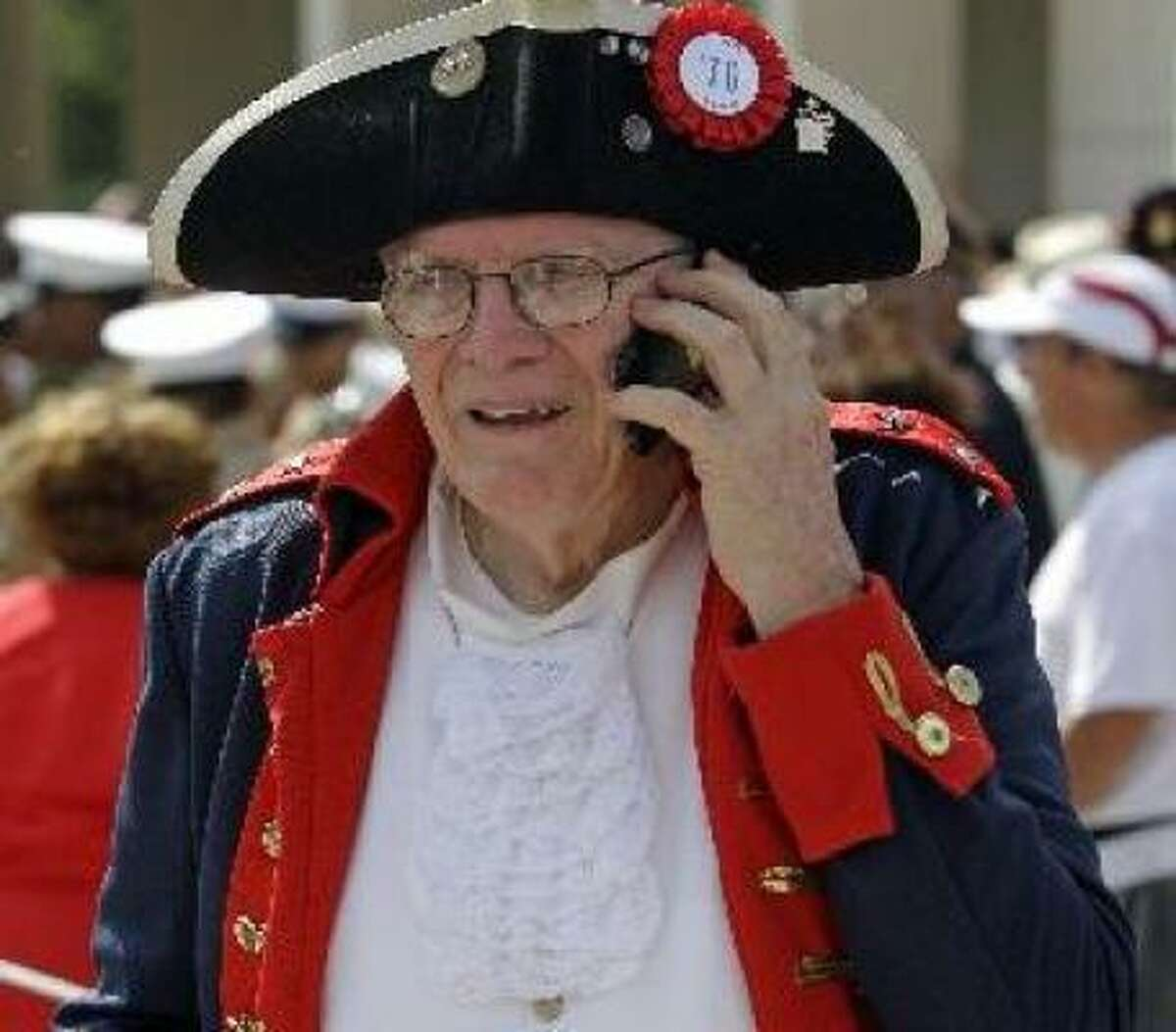 Terry McKee of Tomball with the National Sojouners Houston Chapter 513 takes a break from a parade in Houston on Monday.