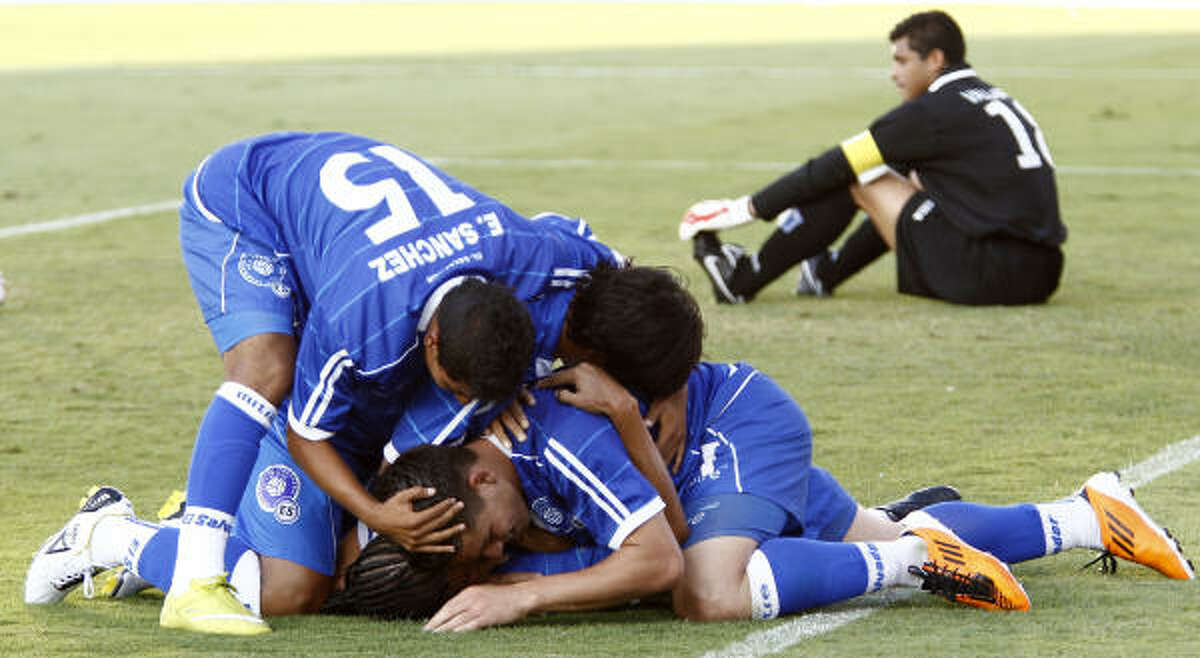 May 29: El Salvador 2, Honduras 2 El Salvador celebrates after forward Rudis Alberto Corrales scored the tying goal in the second half of Sunday's international friendly at Robertson Stadium.