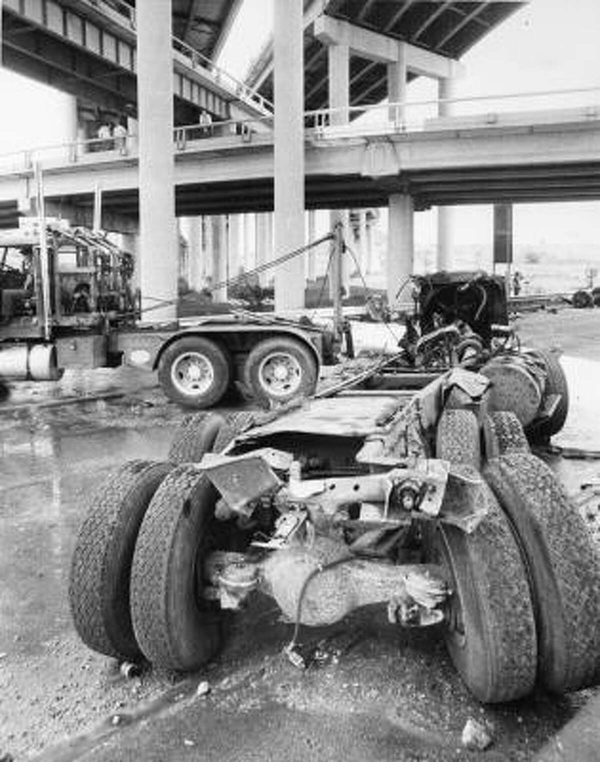 This photo shows the ammonia truck's chassis and vehicle parts being hauled away after the fatal accident and chemical spill of May, 11, 1976.