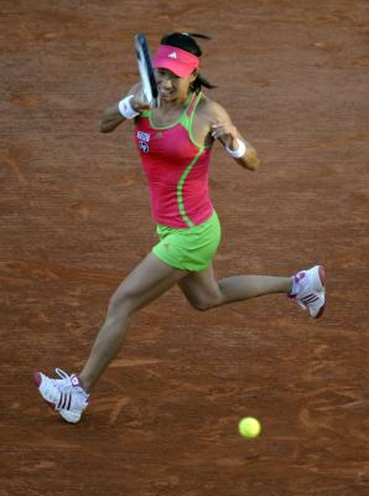 Japan's Kimiko Date-Krumm returns the ball to Denmark's Caroline Wozniacki.